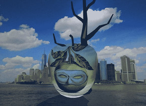 a new york city backdrop.a 3 inch tall apple.a 5 inch tall black tree is -2 inch behind the apple.the apple is 2.35 inch wide [ba].