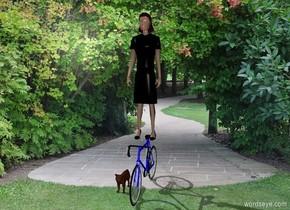 A woman is on a bike. The woman is in a park. A cat sits.