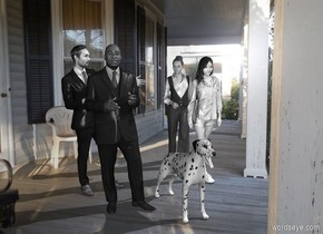 A grey politician is in front of a grey businessman. A grey woman is 2 feet right of and behind the businessman. A grey woman is in front of the woman.  A grey dog is right of and in front of the businessman. Azimuth of the sun is 100 degrees. 45 grey people are 50 feet right of the dog.