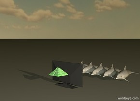 5 small white dolphins are facing forward. a computer monitor is 3 feet in front of the dolphins. the computer monitor is facing the dolphins. a 6 inch tall green pyramid is in front of the computer monitor. the pyramid is 1 foot above the ground. it is dawn.