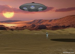 In the desert. The sun is setting. The sky is orange.There is a UFO in the sky. There is a dancing alien.