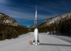 [transportation [wood] ]  atlas rocket. Next to the rocket is a virus. The virus is 1000% big.