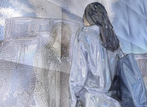a 850 inch wide and 620 inch tall shiny flat wall.the wall is 22 inch wide [glass].a shiny woman is behind the wall.backdrop is shiny .ground is visible and shiny blue.ground is 350 feet tall.ground is [glass].camera light is gray.