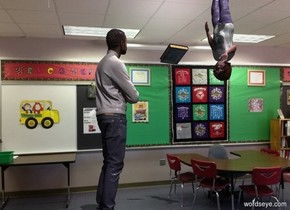 A teacher is in a classroom. A child is -1 foot above and 3 feet in front of the teacher. The child is upside down. The child is facing the teacher. Camera light is black. A light is left of and 2 feet above the child. A 20% shiny book is above and 2 feet in front of and right of the teacher. It is facing east. It is leaning front.