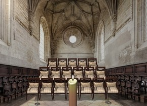 a [church] backdrop. five chairs.six chairs are 30 inch in front of the five chairs.seven chairs are 30 inch in front of the six chairs.a 70 inch tall candle is 20 inch in front of the seven chairs.