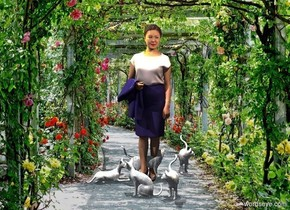 a woman is standing in a garden. it is noon. a 1st [pattern] cat is -.6 feet in front of and right of the woman. a 2nd [pattern] cat is -.5 feet in front of and left of the cat. it faces left. a 3rd [pattern] cat is behind and left of the cat. it faces the woman. a 4th [pattern] cat is behind and -.5 feet right of the cat. it faces right.  a 5th [pattern] cat is behind and right of the woman.  a 1st big butterfly is left of and -.5 feet above the woman. it faces the woman. it leans to the right. a 2nd big butterfly is in front of and -.1 feet right of and -1 foot above the woman. it faces southwest. it leans to the front. camera light is black. a linen light is 10 feet left of and 5 feet in front of and 10 feet above  the 1st cat. a tiny yellow light is above the 1st butterfly. a tiny peach puff light is above and behind the 2nd butterfly.