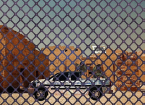 a cobalt blue fence is .2 feet below the ground. backdrop is Egypt. a tiny dull [metal] truck is 3 feet behind the fence. it faces left. it leans 5 degrees to the right. the 1st tiny brute is -1 feet above and -.5 feet behind and -2 feet right of the truck. 2nd tiny brute is -.007 feet right of and -1.8 feet above the 1st brute. it faces southeast.it leans to the front.  a tiny [image-15923] flag is -1.3 feet left of and -.6 feet above and -.2 feet in front of the 2nd brute. it leans 10 degrees to the right. a tiny [metal] gun is -.5 feet above and -.4 feet left of and -.1 feet in front of the 1st brute. it faces southwest. it leans back. camera light is  delft blue. mango orange light is in front of the truck. a maize yellow light is in front of the 2nd brute. ambient light is brass. sun's azimuth is 250 degrees. sun's altitude is 80 degrees. shadow plane.